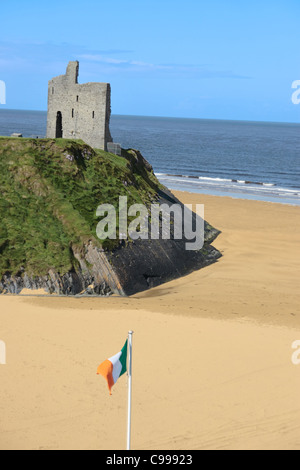 a view of the beach in ballybunion co kerry ireland with irish flag - Stock Photo
