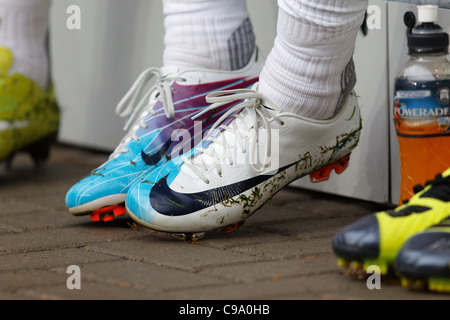 Close up of a Brazil player's footwear on the team bench before a 2011 Women's World Cup Group D match between Brazil - Stock Photo