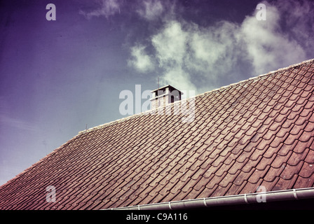 OLD ROOF WITH CHIMNEY - Stock Photo
