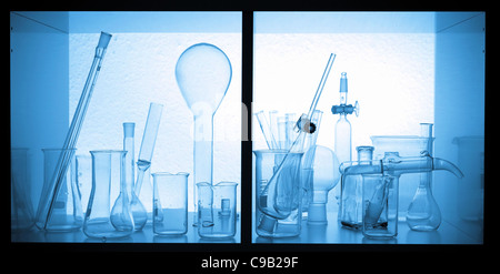 Chemical glassware tubes, bottles in a box chemical laboratory - Stock Photo