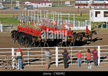Canada, Alberta, Lethbridge, Royal Canadian Mounted Police Musical Ride, RCMP cavalry in full dress red serge uniform - Stock Photo