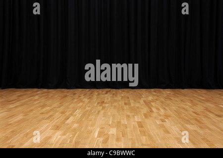 Small stage with black velvet theater curtains - Stock Photo