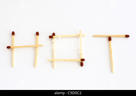 Matches in a shape of the word hot. - Stock Photo