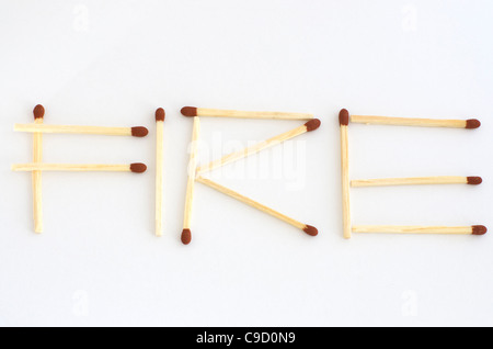 Matches in a shape of the word fire - Stock Photo