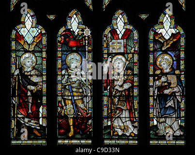 Stained glass window by the Kempe Studios depicting Archangels, St Mary the Virgin Church, West Quantoxhead, Somerset, - Stock Photo
