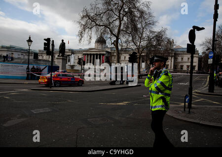 London, UK, 08, 03, 2012, Police place a  cordon around Trafalgar Square as police bomb squad officers destroy a - Stock Photo