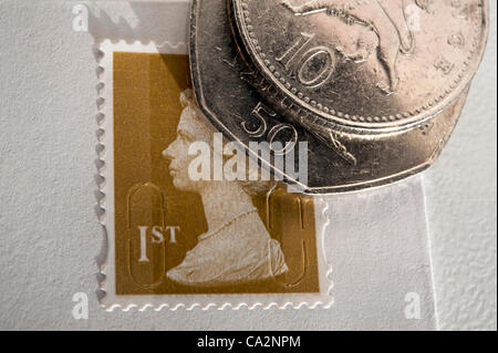 UK 27th March 2012. The Royal Mail announces a rise in price of first class stamps to 60 pence. Prices will rise - Stock Photo