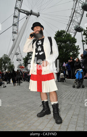 3rd June 2012. Southbank, London, UK. With The London Eye in the background a man in a kilt is enjoying the Pageant - Stock Photo
