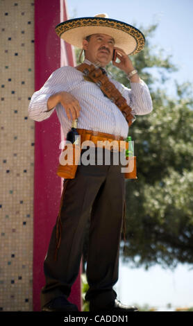 Aug 09, 2010 - Austin, Texas, U.S - Mexican on cellphone at State Capitol during President Obama's visit. (Credit - Stock Photo