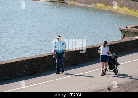 Swansea - UK - 22nd May 2012 - People out walking in the warm sunshine at Mumbles near Swansea today. - Stock Photo