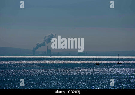Swansea - UK - 22nd May 2012 - Glistening sea at Mumbles near Swansea today with the Port Talbot steelworks in the - Stock Photo