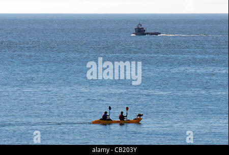 Swansea - UK - 22nd May 2012 - Kayakers taking their dog for a paddle at Langland Bay near Swansea today in the - Stock Photo