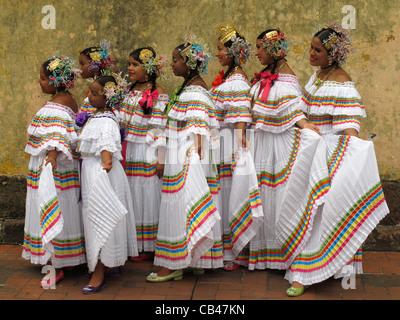 Panamanian girls wearing the 'pollera tireada', a panamanian typical costume, at the Panama city old town. - Stock Photo