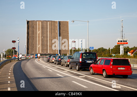 The bridge is up on the main road passing The Falsterbo Canal in the southern Sweden and traffic is waiting for - Stock Photo