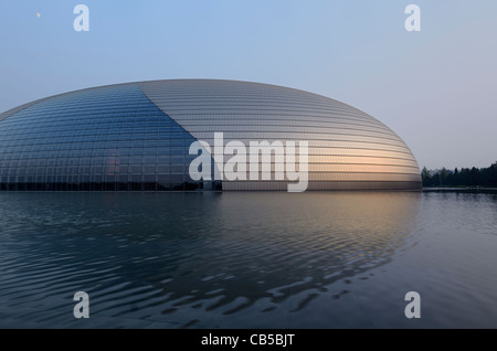 National Centre for the Performing Arts at dusk with moon in Beijing Peoples Republic of China - Stock Photo