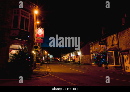 Christmas lights down the main street Castleton Derbyshire. - Stock Photo