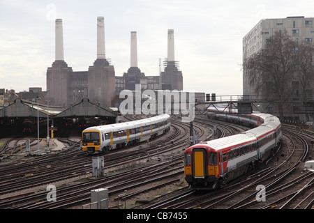 Railway Lines near London's Victoria Station with Battersea Power Station in the Background - Stock Photo