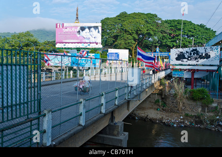 Heavily loaded bicycle crosses international bridge between Thailand & Myanmar with sign 'Republic of the Union - Stock Photo
