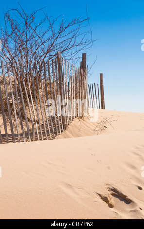 Cape Cod beach fence and sand dunes at beach entrance in Chatham, Cape Cod - Stock Photo