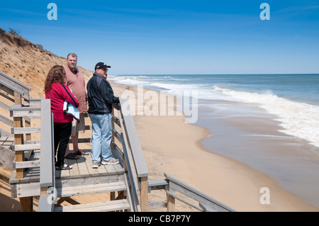 People watching the ocean at stairs of Marconi Beach, Cape Cod - Stock Photo