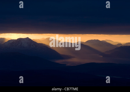 Coast of the West Highlands at sunrise, at the mouth of Loch Hourn, Knoydart, showing Beinn Sgritheall (974 metres) - Stock Photo