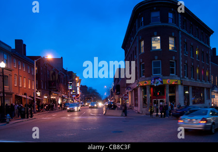 Intersection on Harvard Square with student bookshops and restaurants in Cambridge, MA - Stock Photo