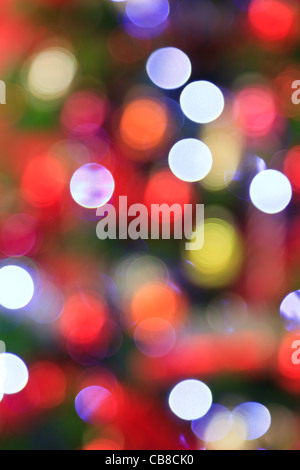 Photo of the lights from a Christmas tree deliberately taken out of focus for use as a colourful background. - Stock Photo