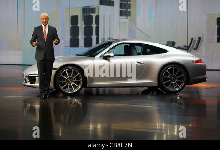Matthias Muller (Mueller), Chairman of the Board Porsche AG, presents Porsche 911 of the sixth generation, during - Stock Photo