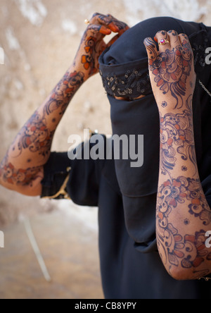 Unrecognizable Young Woman Wearing Hijab Veil Shows Palm Of Her Hand Painted With Henna And Indigo Blue, Lamu, Kenya - Stock Photo
