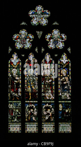 Stained glass window by the Kempe Studios depicting the Archangels Raphael, Michael, Gabriel and Uriel - Stock Photo