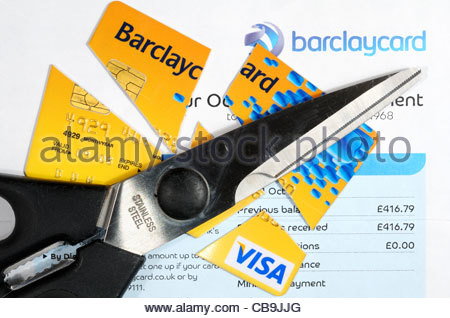 Top down image of a cut up Barclaycard credit card alongside scissors and statement, England - Stock Photo