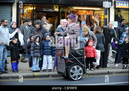 Street entertainer from Granny Turismo on shopping trolley in Wolverhampton England Uk - Stock Photo