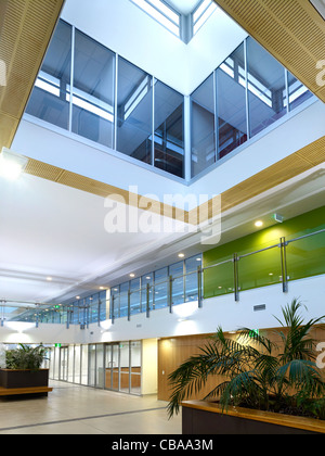Modern commercial interior foyer featuring daylight atrium - Stock Photo