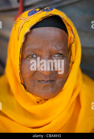 A Portrait Of An Old Black Lady Dressed Wearing  Vivid Yellow Veil On Her Head Hargeisa Somaliland - Stock Photo