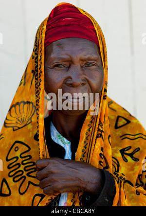 Mid Adult Woman Wearing Yellow Veil Portrait, Lamu, Kenya - Stock Photo