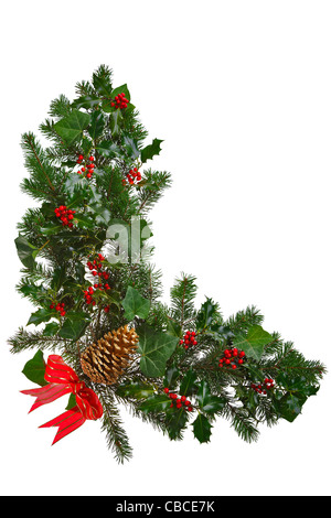 Photo of a Christmas garland in an L shape with holly, red berries, ivy, spruce, pine cone and a red bow. - Stock Photo