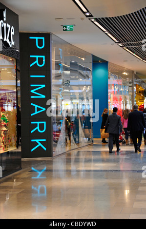 Primark shop front store sign & shoppers people walking Westfield shopping centre mall at Stratford City Newham - Stock Photo