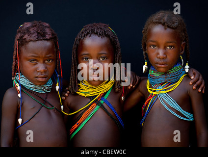 Mwila Girls With Traditional Hairstyle And Beaded Necklaces, Angola - Stock Photo