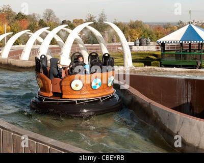 Visitors, in the river splash ride in Legoland, Berkshire, UK - Stock Photo