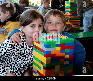 Boy and girl enjoying playing with Lego in Legoland, Windsor, Berkshire, United Kingdom - Stock Photo