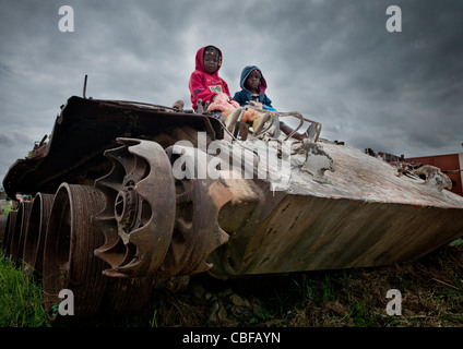 Kids On A Tank Wreck From Civil War, Angola - Stock Photo