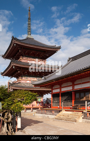 The Hall of Writings (Sutra Hall) and three storey pagoda in the Kiyomizu-dera temple complex, Kyoto, Japan. - Stock Photo