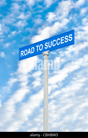 A road to success street sign against a blue, cloudy sky - Stock Photo