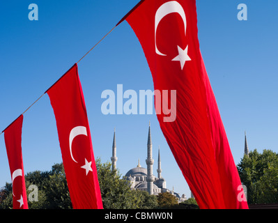 Turkish Flags and Sultan Ahmed Mosque aka Blue Mosque - Stock Photo