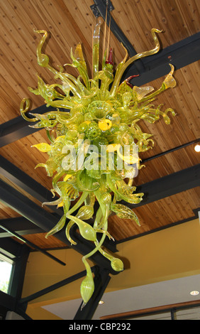 Dale Chihuly glass flower arrangement hanging from the ceiling at the admissions building at Atlanta Botanical Garden - Stock Photo