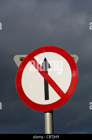 No Entry traffic sign against stormy sky, Clonakilty, County Cork, Republic of Ireland. - Stock Photo