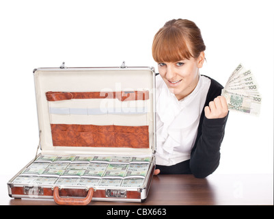 Brown briefcase full of hundred zloty money isolated on white - Stock Photo