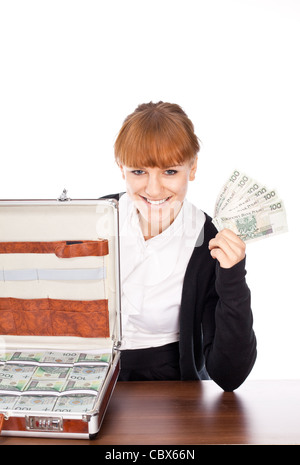 happy Businesswoman hold Brown briefcase full of hundred zloty money isolated on white - Stock Photo