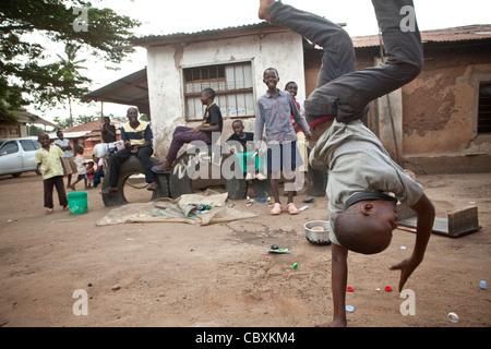 Children perform acrobatics in a slum in Morogoro, Tanzania, East Africa. - Stock Photo