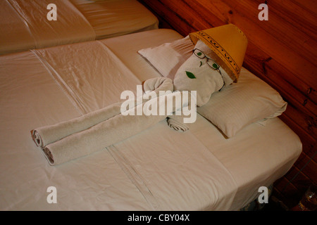A towel man on our hotel bed. - Stock Photo